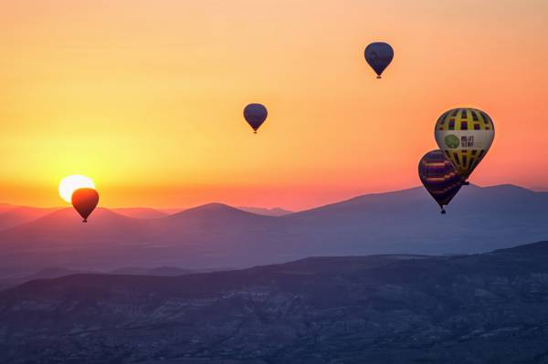 Hot air balloons floating into the sunset over Steamboat Springs, CO