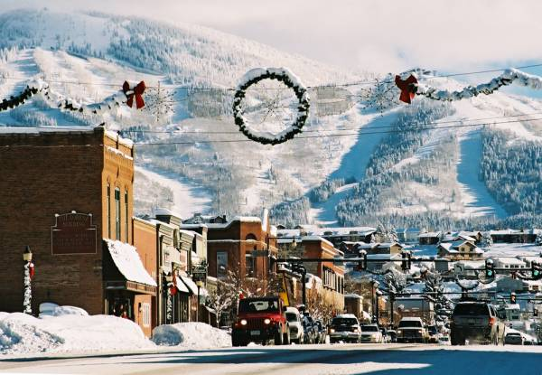A beatiful view of downtown Steamboat Springs with a snowy mountain in the background